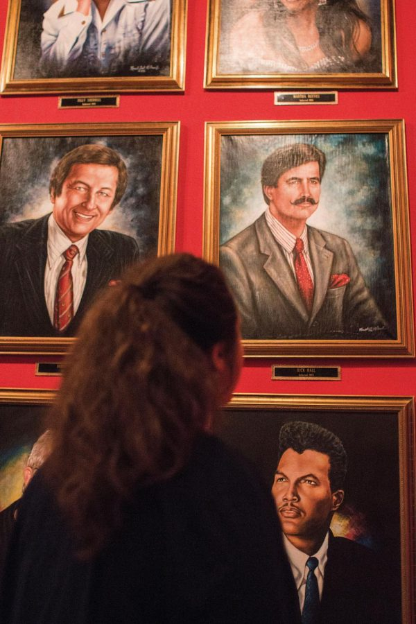Graduate student Taylor Goodwin observes the portrait of former FAME Recording Studio owner and producer Rick Hall at the Alabama Music Hall of Fame. Hall died Jan. 2 at the age of 85, leaving behind a musicallegacy in the Shoals.