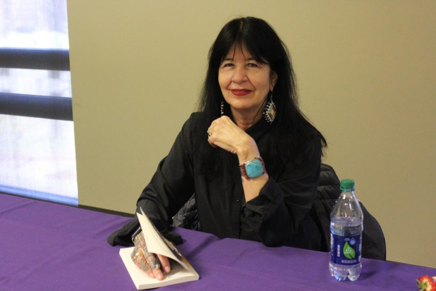 Poet Joy Harjo prepares to sign another book at the 34th annual Writer's Series March 15. Harjo read excerpts from her works and played music at the Guillot University Center as part of the event.
