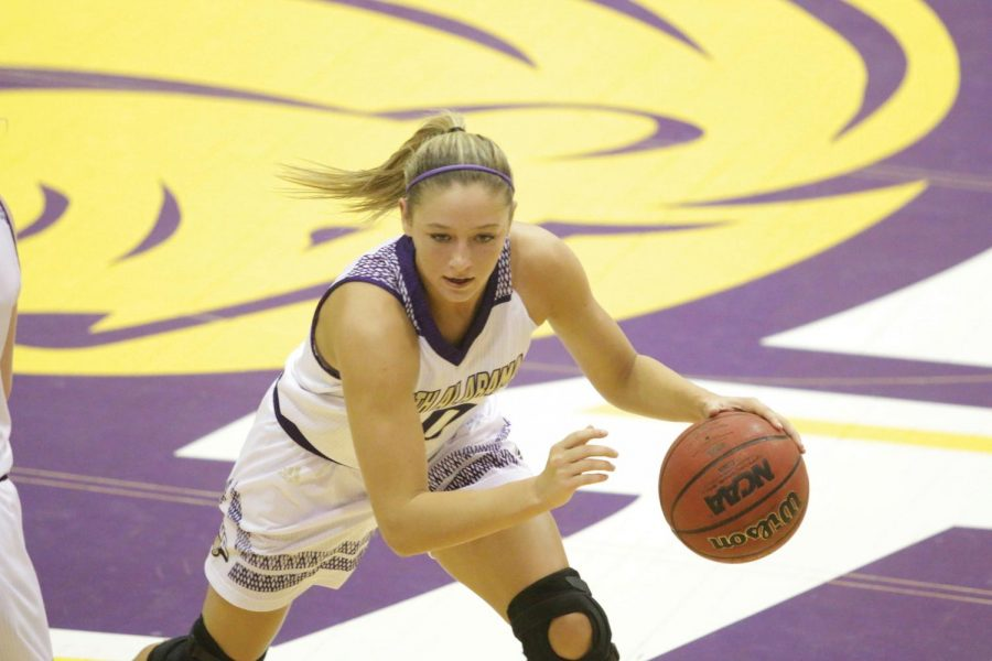 Sophomore+guard+Ansley+Eubank+dodges+an+opposing+player.+UNA+defeated+West+Florida+Jan.+25+to+help+secure+their+NCAA+Tournament+invitation.