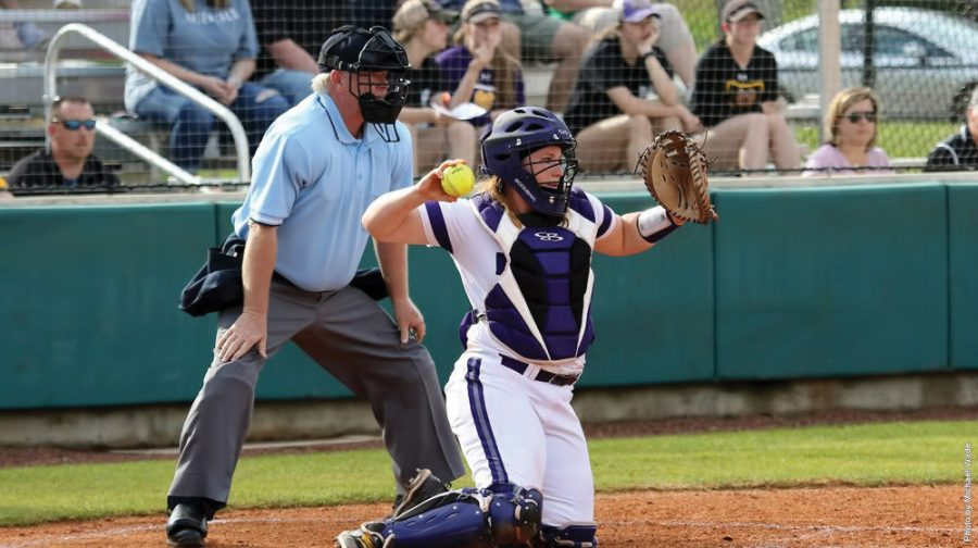 Junior catcher Mackenzie Roberts throws down against Montevallo March 18. The Lions won with a score of 7-2.