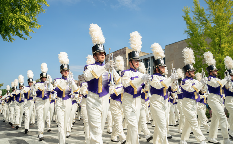The+Marching+Pride+leads+the+annual+homecoming+parade+through+downtown+Florence+on+Sept.+28.
