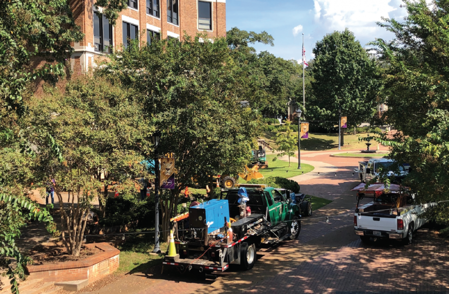 Maintenance+vehicles+form+line+of+caution+during+safety+procedures+to+eliminate+a+potentially+dangerous+gas+leak+at+Bibb+Graves+Hall.+Caution+tape+was+put+up+as+well+to+keep+students%2C+staff+and+faculty+away+from+exposure+to+the+leak+or+any+danger+it+posed.