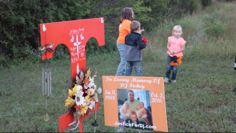 Above is DJ Fickey's memorial in Walker County, Ga. Amanda Shirley's daughter, Serena and Fickey's children, Jack and Paisley wait patiently to decorate it with new flowers.