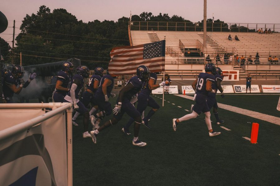 The UNA Lions showed support entering the game for the lives lost on 9/11/2001. UNA played UTC on the 20th anniversary of the horrific attacks.