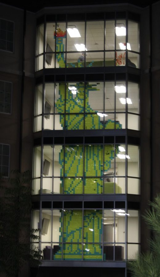 In+the+windows+of+Olive+Hall%2C+stands+a+four+floor+tall+Statue+of+Liberty+made+soley+of+Post-It+sticky+notes.+Freshmen+Kenny+Davies+and+Abbie+Grace+Warren+dedicated+eight+hours+on+the+mural+and+used+up+to+1%2C500+sticky+notes.